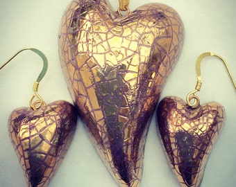Gold heart pendant and earring set.
