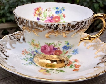 Beautiful Rosina Gold and Floral Footed Teacup and Saucer