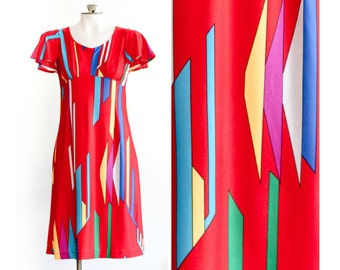1960s red flutter sleeve dress with geometric pattern print