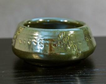 Decorative hand thrown ceramic dish
