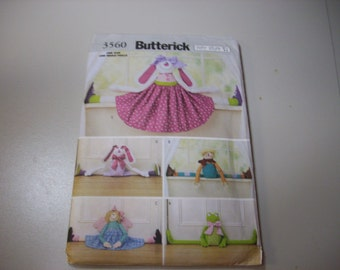 Draft dodgers sewing  Butterick pattern # 3560 to make a bunny scarecrow girl  and frog is uncut