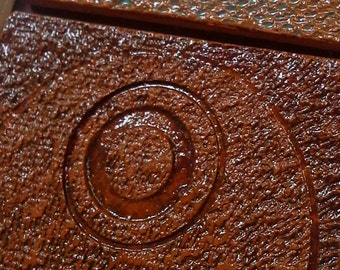 Richly textured ceramic tiles. Set of 3