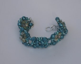 By bracelet faceted crystals.