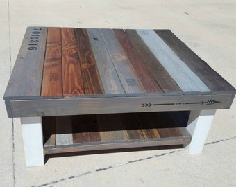Reclaimed wood coffee table with multi-colored stain and lower shelf.  Farmhouse-style,  shabby-chic style furniture,  fixer upper style