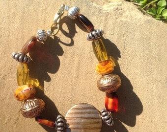Beaded bracelet- Harvest glass and metal, gold, reds,oranges
