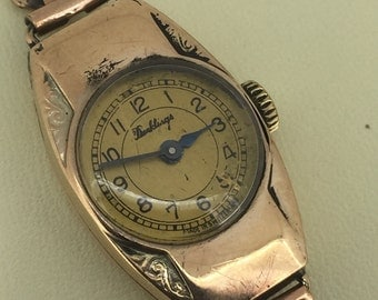 An Edwardian 9K Yellow Gold ladies' wristwatch. Circa 1920's. Retailed by Dunklings. Swiss made.