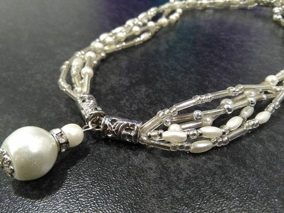 Lovely handmade necklace with white pearls, glass beads and silver details