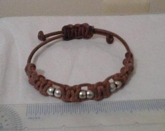 Adjustable leather macrame bracelet.