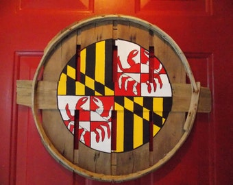 Maryland state flag center circle w/ crab Greek Cross. Hand painted on recycled crab bushel lid.