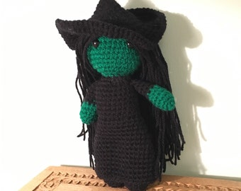 Elphaba the green witch from Wicked with hat
