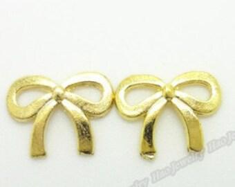 50pcs 11mm gold bowknot no.161