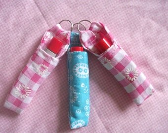 Lip balm key ring with free lip balm