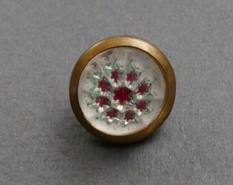 Rare glass button