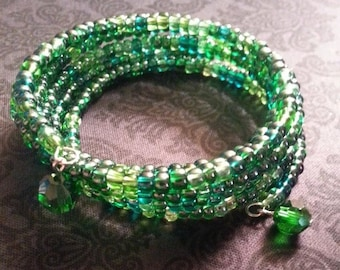 Long Green seed bead memory wire wrap bracelet with green round crystal dangles
