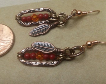 Earrings in red coral, crystal and copper.