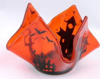 A Halloween orange candlestick
