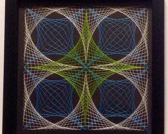 Framed geometric thread / string art