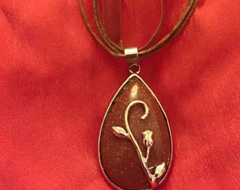Goldstone silver flower pendant on brown organza ribbon necklace