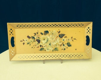 Decrative hand painted flowers on a tin serving tray