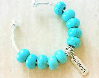 Namaste Charm Turquoise Bead Silver Plated Bangle Bracelet 7.5 Inches
