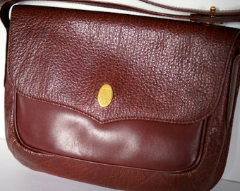 Cartier Burgundy Red leather bag.