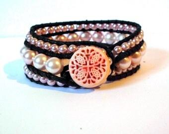 Pink wrap, black leather cord bracelet