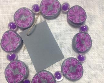 Fantastic gray bracelet with purple accents