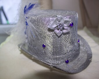Silver and blue mini top hat.