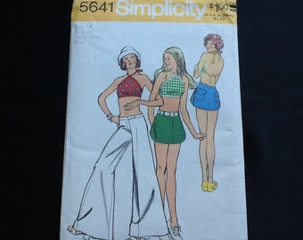 Simplicity pattern 5641. Vintage uncut 1973 misses' halter top, mini skirt and bell bottom hip hugger jeans. Size 12.