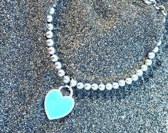 Blue enameled heart-shaped charm bracelet