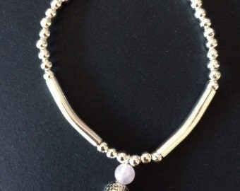 Rose quartz and silver beaded and noodle stretch bracelet with buddha charm. Uk seller