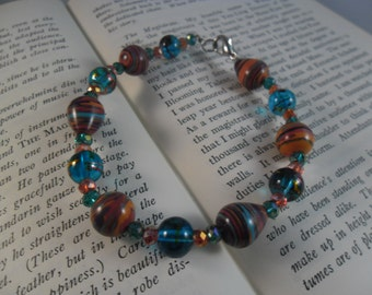 Turquoise and Coral Toned beaded bracelet with silver finish lobster clasp