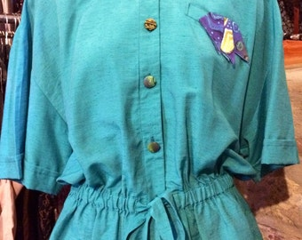 1990's short sleeves, turquoise colored hoodies, shoulder pads. Size S.