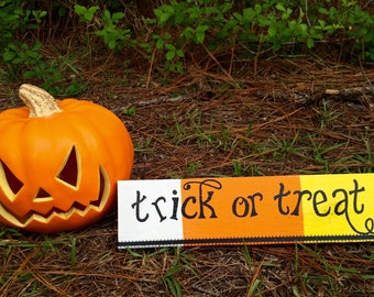 """Wooden hand painted """"Trick-or-Treat"""" sign"""