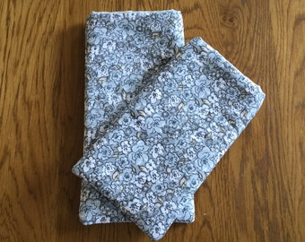 Phone sleeve in grey floral fabric