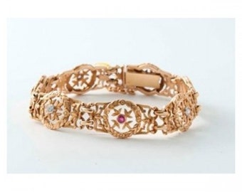 Former Mineralife bracelet in pink gold, diamonds and rubies
