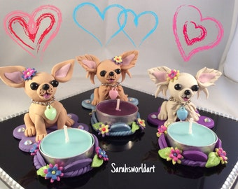 Chihuahua tea lite candle holders, including one candle.