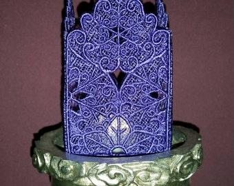 H011.  Deep purple lace tealight.