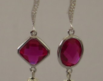 925 Sterling Silver earrings and Ruby zirkonias set in 925 sterling silver