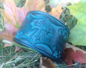 Womens hand stamped leather cuff, bordered cross pattern, black over turquoise.
