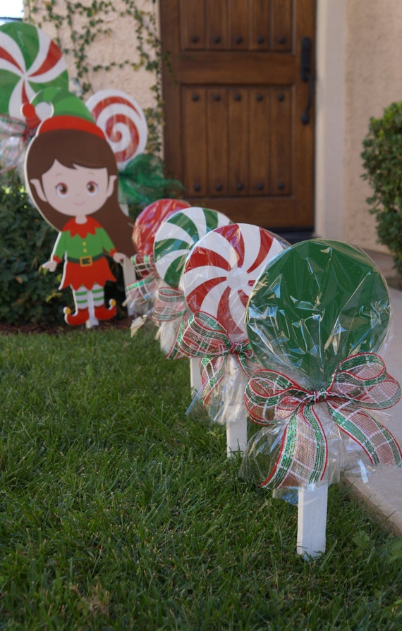 Wooden christmas lollipops for yard decorations by for Christmas yard ornaments