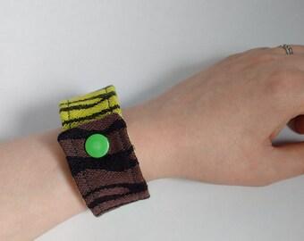 Wrap arounf fabric cuff bracelet with zebra print made from babywearing wrap fabric Zebra Savanne in yellow, green and brown
