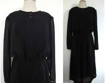 Black and pleated voile dress