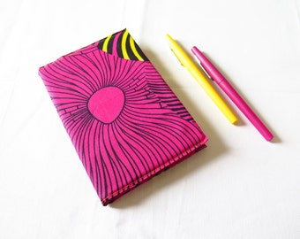 Notebook 11 * 16 cm, protected by a vivid pink and yellow wax cloth