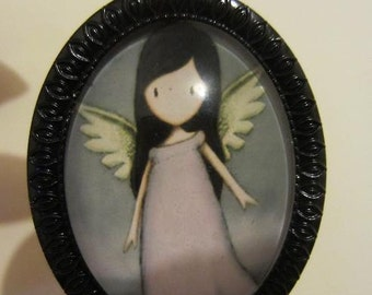 Gorgeous Angel cameo pendant on black metalwork frame.