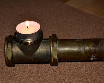 Candlestick made of plumbing parts