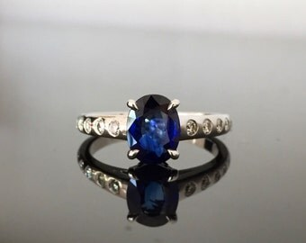 Ring solid white gold 18 k is main, diamond and blue Sapphire.
