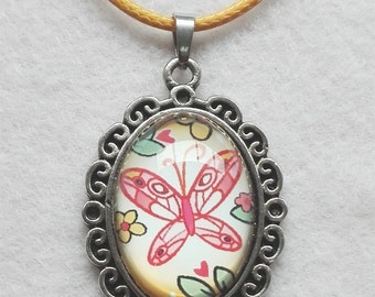 Girls necklace, with sweet little butterfly illustration in pendant with glass