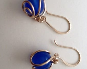 Goldfilled wire wraped around bead dangle earring.