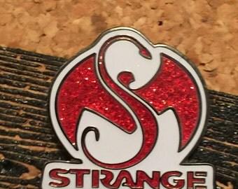 Red strange hat pin